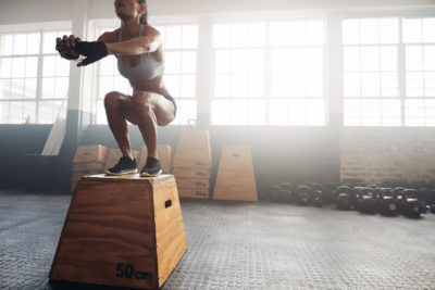Woman Jumping On A Training Block